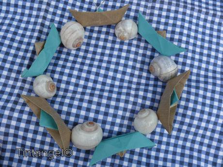 Bootjes en schelpen aan ring
