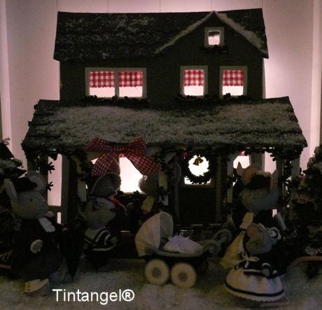 Kersthuis bij nacht verb en bijgesneden blog