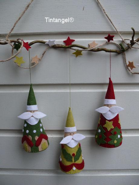 Drie Kerstmannen aan deur blog